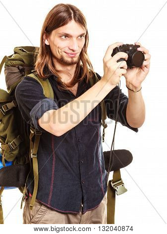 Man tourist backpacker on trip taking photo picture with camera. Young guy hiker backpacking. Summer vacation travel. Isolated on white background.