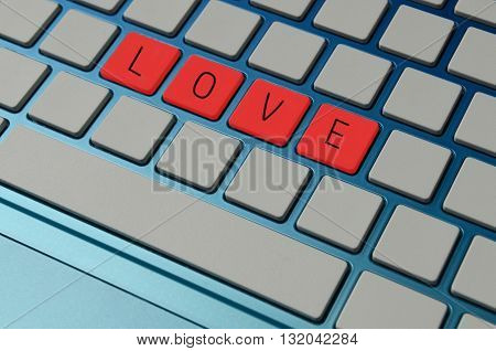 Online dating and finding love concept with a computer