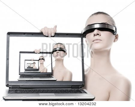 Beautiful cyber woman with a laptop computer. Isolated on white background