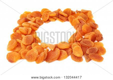 Round shape made of dried orange apricots over isolated white background