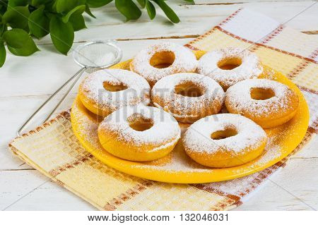 Delicious donuts on yellow plate. Sweet dessert. Sweet pastry. Doughnuts.