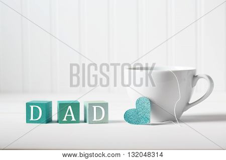 Father's Day message with coffee cup with wooden blocks