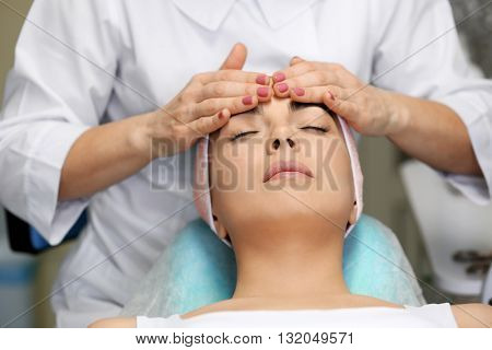 Young woman having face massage in a beauty salon