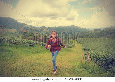 Girl And Tea Plantation