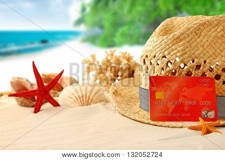 Credit card on holiday on blurred resort background