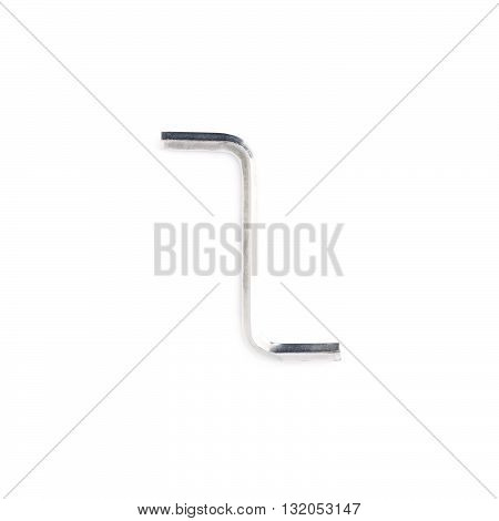Hex metal allen S key over white isolated background