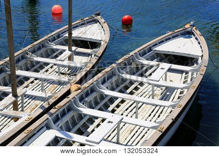 white boats over blue sea water on moorage