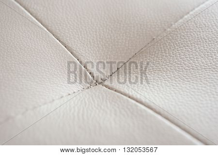 stitch of a gray sofa close up horizontal