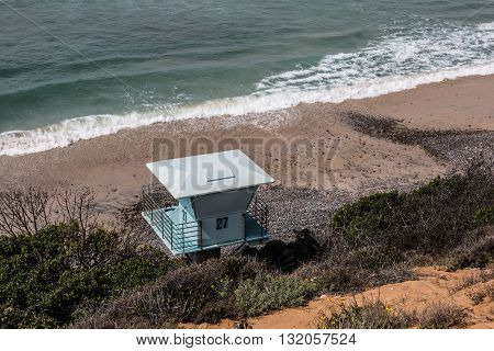 View from above of a lifeguard tower at South Carlsbad State Beach in Carlsbad, California.