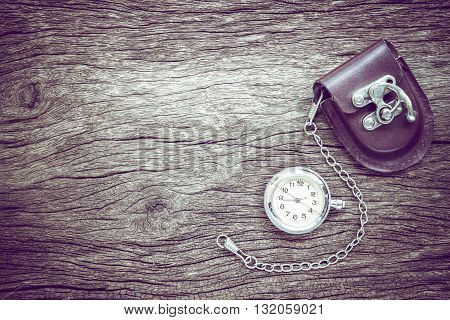pocket watch on old wooden background .
