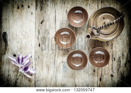 Tea cups with teapot on old wooden table. Top view.