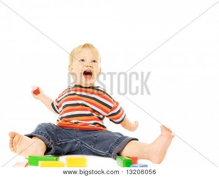 Beautiful young child playing game. Isolated on white background