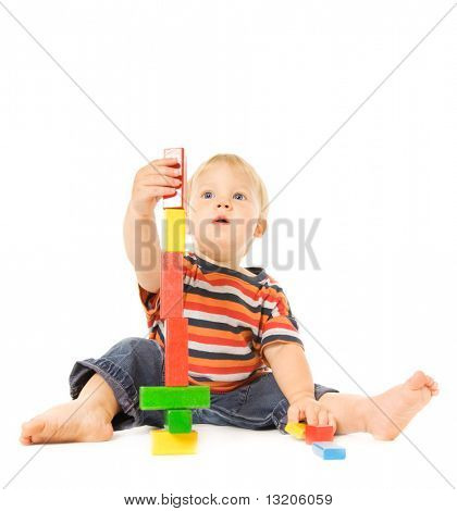 Beautiful young child playing intellectual game. Isolated on white background