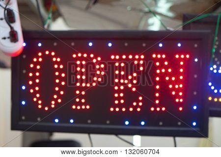 Neon Open Sign - red neon open sign hanging