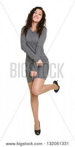 young girl beauty portrait full length raise leg, black and white checkered dress, long curly hair, glamour concept, isolated on white background