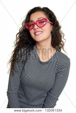 young girl beauty portrait, black and white checkered dress, pink sunglasses in heart shape, long curly hair, glamour concept, isolated on white background
