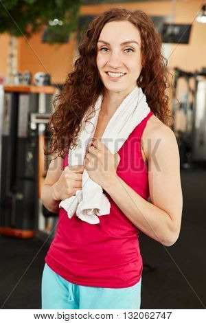 Happy and sporty woman training at the gym