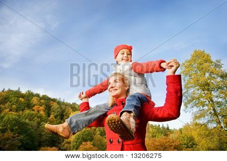 Mother and daughter having fun outdoors