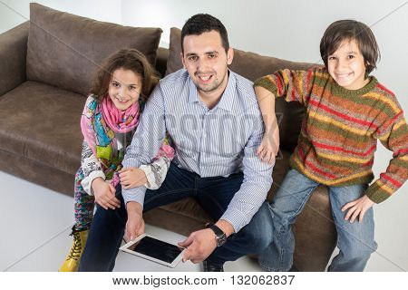 Father and kid on sofa at home