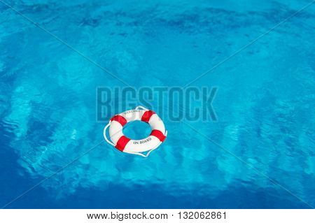 Life buoy floating on water with text welcome on board