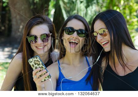 young brunette girl models listening to music on phone
