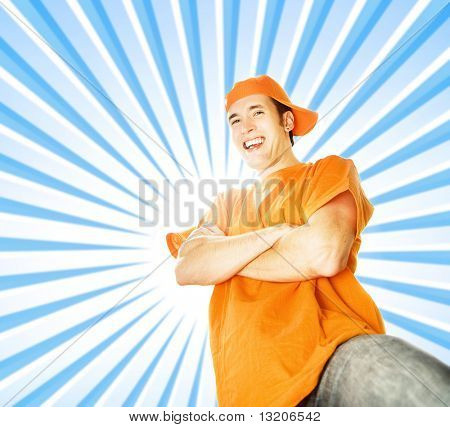 Handsome young man over abstract blue background