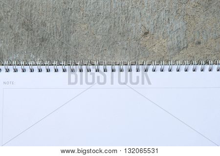 spiral ring bound white calander on stone background