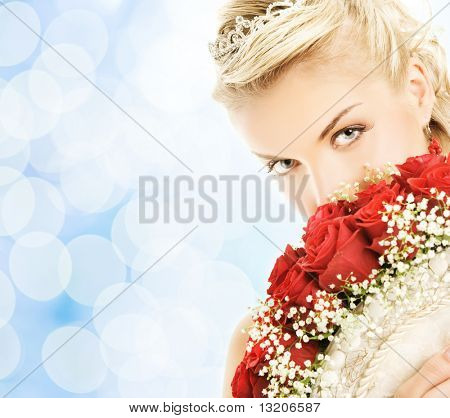 Beautiful bride hiding behind luxury bouquet of roses