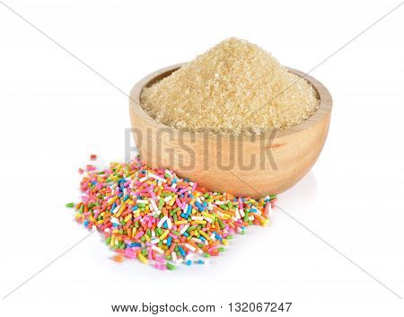 brown sugar in wooden bowl and sugar cake decoration on white background