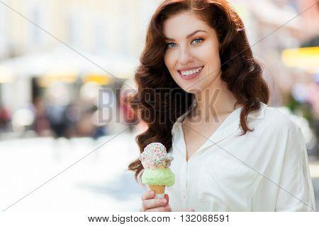 Beautiful woman enjoying an ice cream