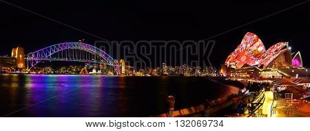 SYDNEY AUSTRALIA - May 29 2016 Panorama of Sydney Opera House and harbour bridged illuminated with colourful light design imagery during the Vivid Sydney 2016 annual public event.