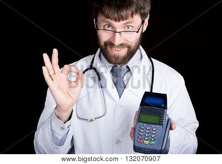 close-up portret of a Doctor holding pos-terminal, stethoscope around his neck. he makes an OK sign with your fingers, offering to pay. different emotions.