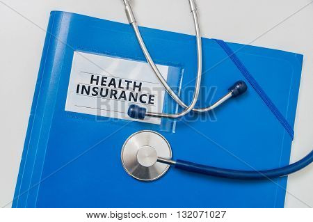 Blue folder with files of Health Insurance.