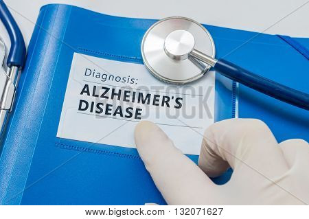 Blue folder with Alzheimer's disease diagnosis and stethoscope
