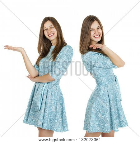 Happy beautiful young brunette women in a turquoise dress on white background. Studio portrait