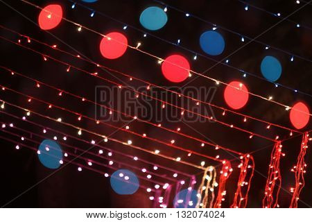 Decoration done with colorful lighting wires during a traditional festival or ceremony.