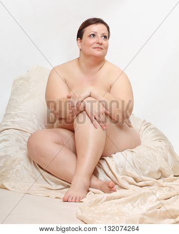 Overweight woman relaxing in the bedroom. People in different situations. Healthy lifestyle, slimming and dieting theme. Weight loss idea.