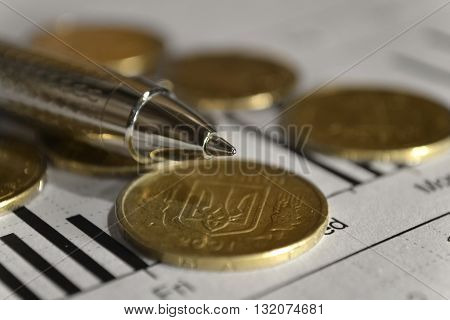 Financial background with money graph and pen.