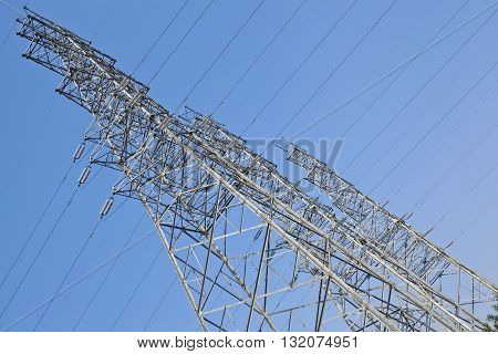 look up at  high voltage power transmission towers