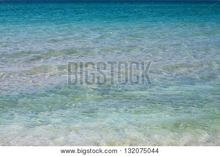 Azure sea water. The palette of shades of blue water. Pleasing to the eye background. The concept of summer vacation, seaside, holiday, happiness