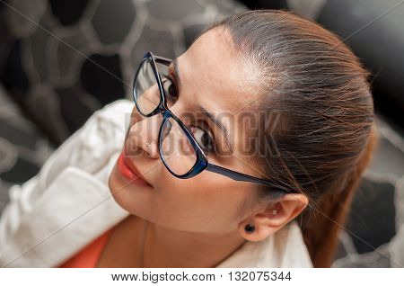 Business woman looking at the camera with spectacle
