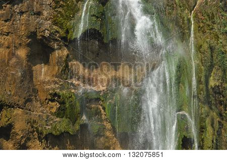 High waterfall the water flowing from the rocks into the lake. National Park Plitvice Lakes. Tourism in Croatia.