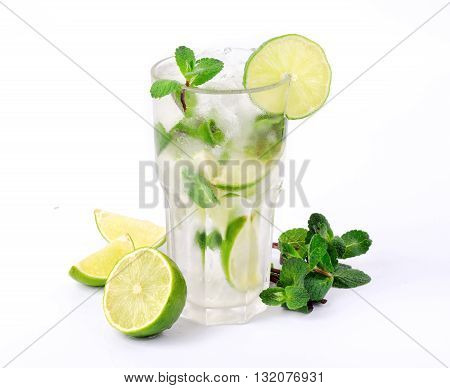 Mojito cocktail with lime and mint in tumbler glass on white background closeup