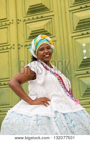 Brazilian woman wearing traditional clothes in Salvador, Bahia, Brazil