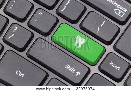 Computer Keyboard Closeup With Tooth Icon On Green Enter Key