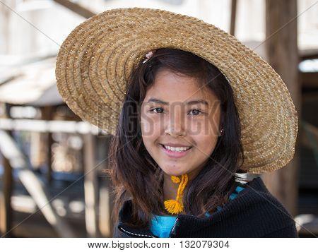INLE LAKE MYANMAR - JANUARY 12 2016: Portrait burmese girl a straw hat in local market. Inle lake Myanmar Burma