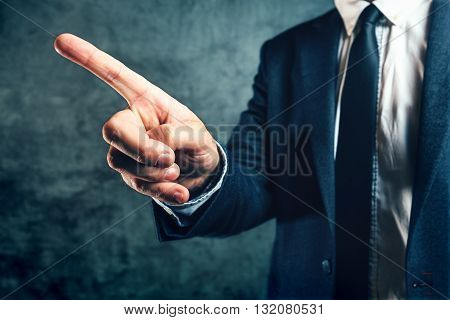 Getting fired from job office manager showing way out with finger pointing to exit door.