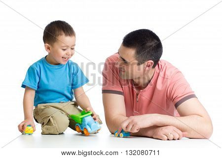 Daddy and little boy playing with toy cars