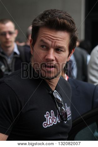 LONDON, UK - AUGUST 6, 2013: Mark Wahlberg seen greeting fans while leaving BBC radio one studio's