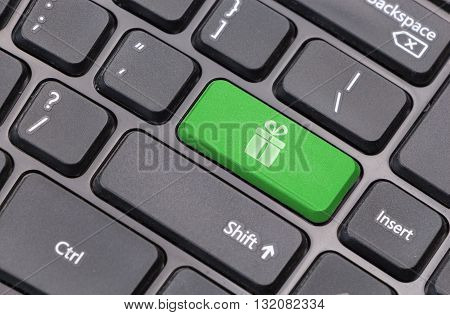 Computer Keyboard Closeup With Gift Box Sign On Green Enter Key